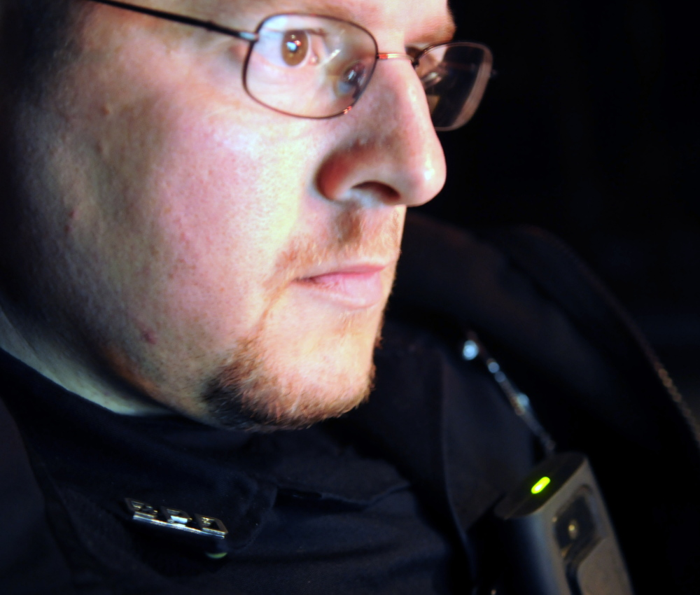 A green light on a body camera attached to Gardiner police Officer Normand Gove signals the device is recording during a recent traffic stop by Gove.