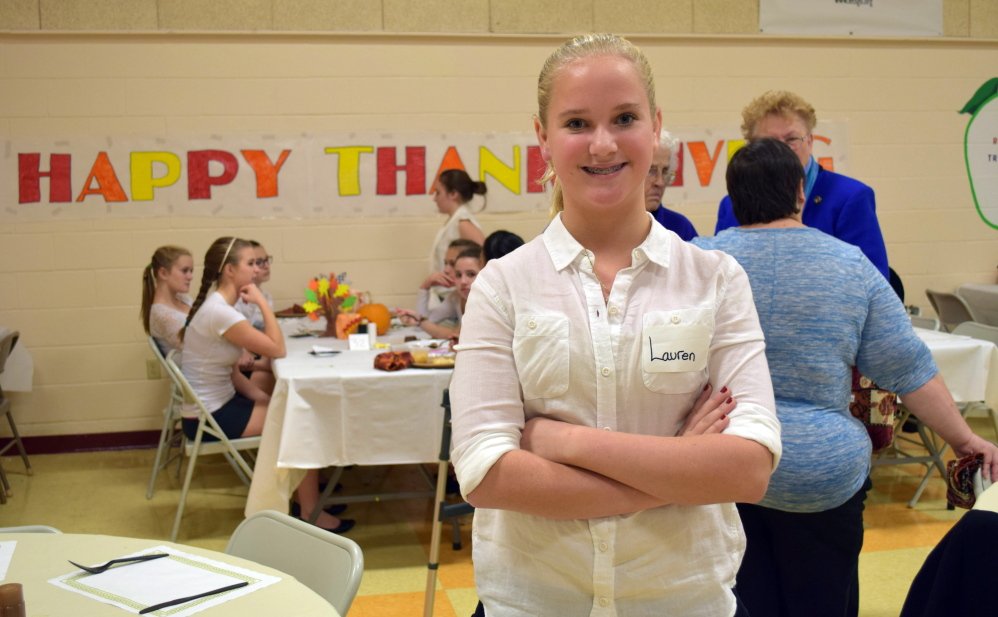 Wells Junior High School student Lauren Bartlet was one of several students who helped wait tables during the Wells-Ogunquit School District's annual Senior Appreciation Thanksgiving Dinner. The meal was served by eighth-grade students as part of their studies and community service efforts.