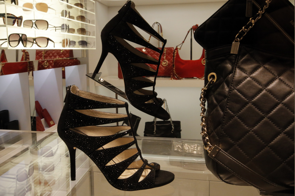 High heels are displayed for sale in a shop in Paris. Scientists from the Universite de Bretagne-Sud conducted experiments that showed that men behave very differently toward high-heeled women.