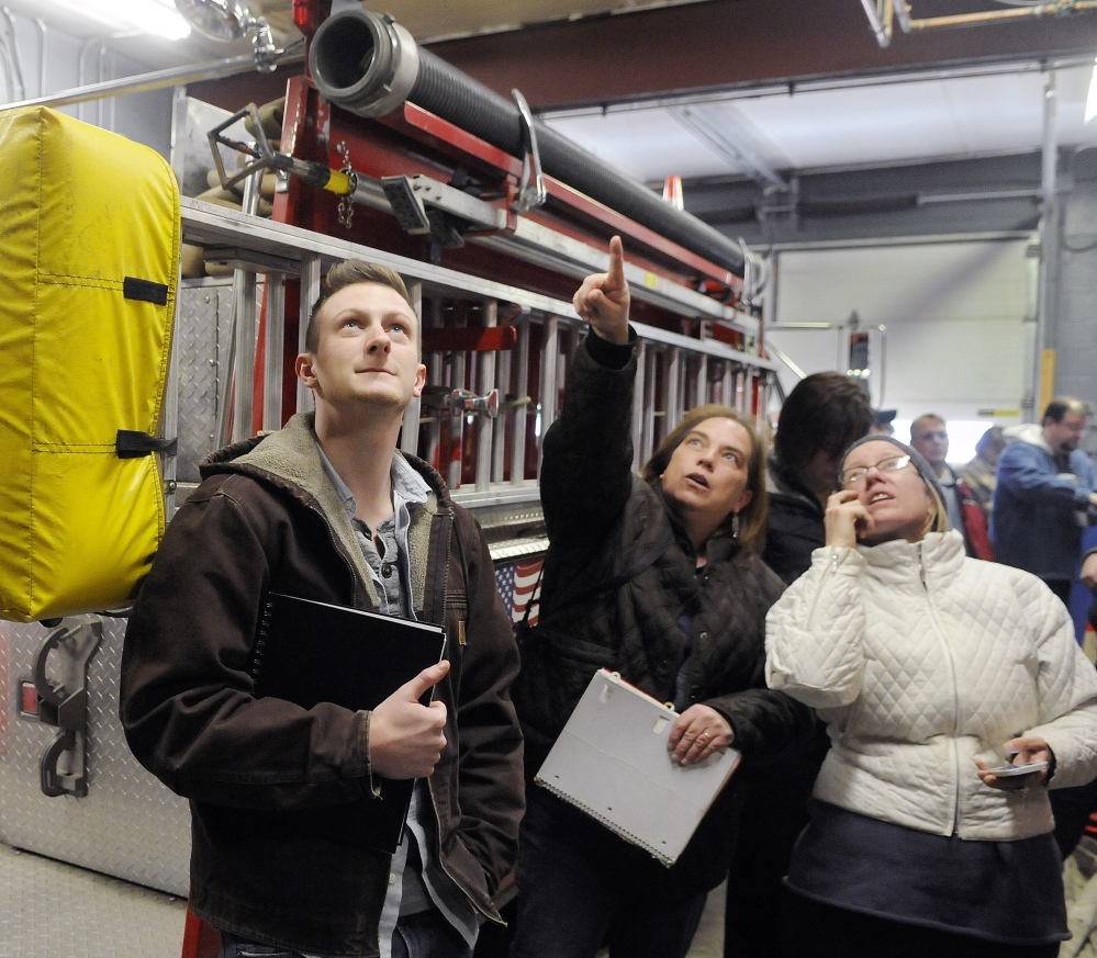 University of Maine at Augusta architecture students tour the interior of the Randolph fire station Monday.