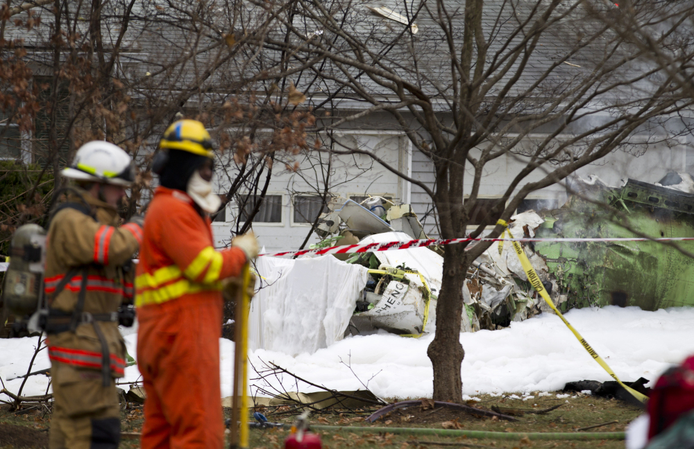 The wreckages of a small plane sits in a house driveway after crashing in Gaithersburg, Md., Monday.