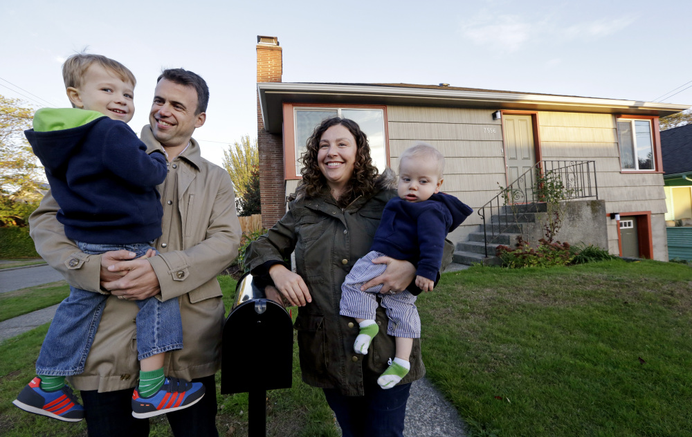 Jennifer Ewing and her husband, Florian Thiel, recently bought a house in Seattle near an elementary school for their children Max, left, and Felix. The couple figured housing would be affordable when they left New York City but instead bought the house for nearly $500,000.