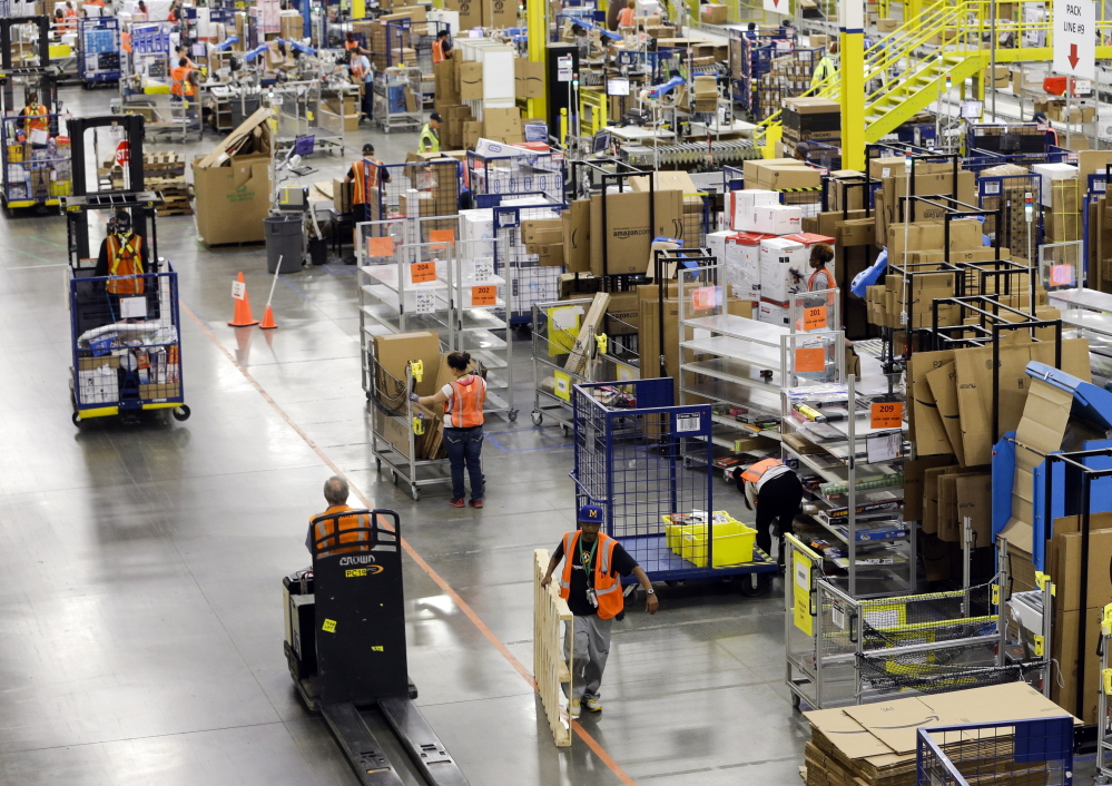 Workers like these at an Amazon fulfillment center in Lebanon, Tenn., are not entitled to pay for their time spent waiting to get through security, the Supreme Court ruled Tuesday.
