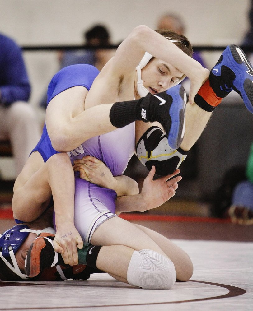 Bradley Beaulieu of Marshwood, on his knees, won the Class A 113-pound title last winter and finished second at the New England qualifier. He is tenacious and a very skilled wrestler as he enters his sophomore year .