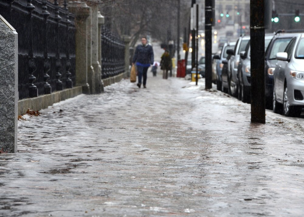 """DEC. 10: Sidewalk conditions during the nor'easter were more slippery than some Portland  residents had seen in a long time.  The slick bricks caused many to shuffle and slide their way around the city, while others gave up and walked on roads that were wet but nowhere near as icy. Others bought up local supplies of urban ice-trekking gear – studded footwear that can be slipped over or strapped on boots and shoes. This stretch of sidewalk along Portland's Congress Street looked more like an ice rink after days of rain, sleet and temperatures hovering around freezing. """"It doesn't take more than a second for you to end up on your keister,"""" said Dr. Nathan Mick, medical director of Maine Medical Center's emergency department."""