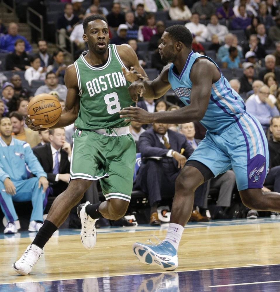 The Celtics' Jeff Green drives against Charlotte Hornet Lance Stephenson during the first half of Wednesday night's game in Charlotte, N.C. Green scored 16 points in the game.