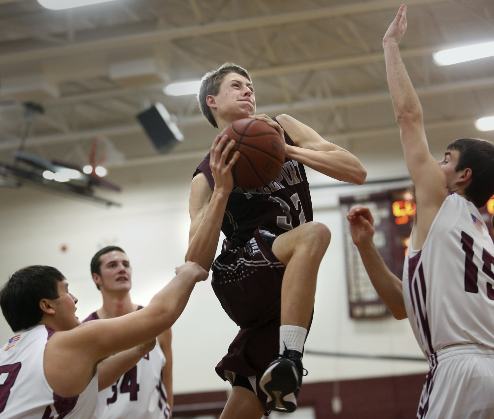 Freeport's Nate Pelletier finds himself surrounded by a tenacious Greely defense that includes Chris Goding during Wednesday night's loss to the Rangers.