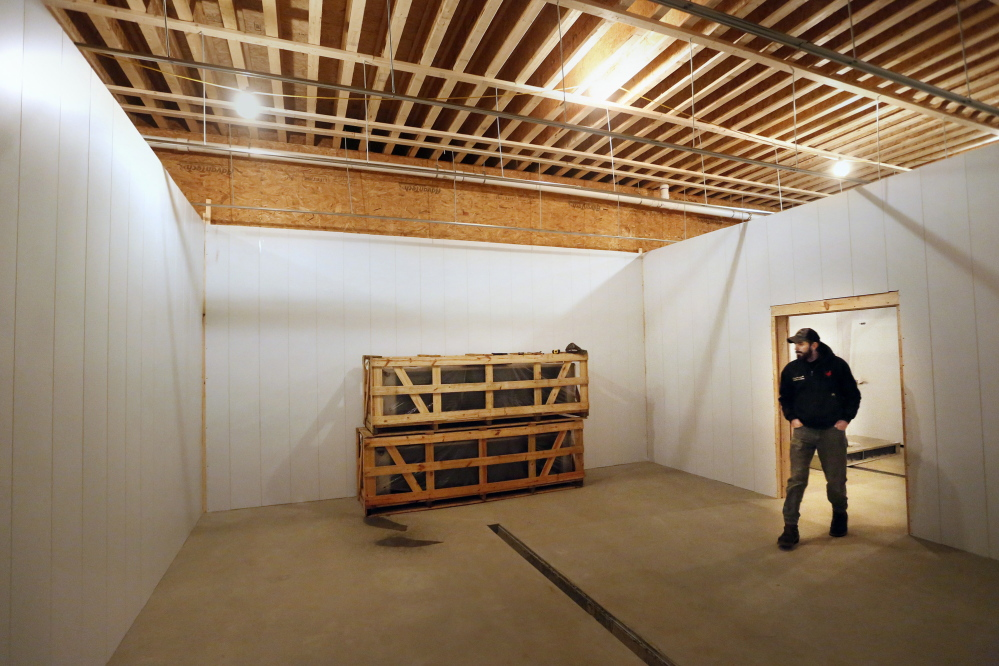 Ryan Wilson, owner of Common Wealth Poultry Co., checks on the construction of a new poultry processing facility.Derek Davis/Staff Photographer