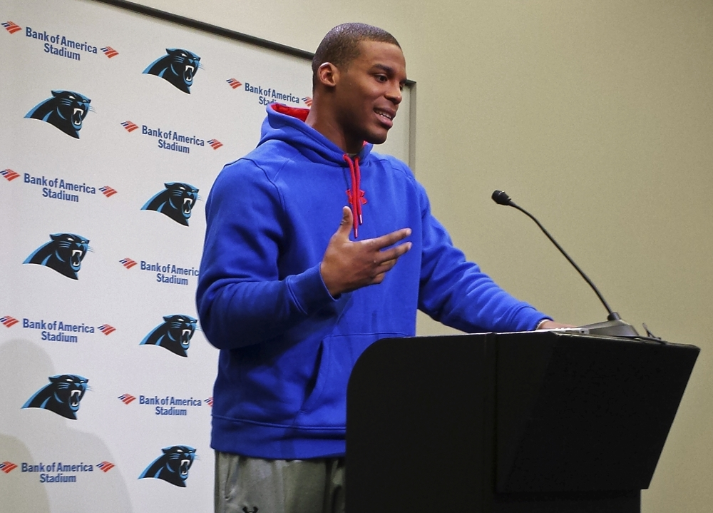 Carolina Panthers quarterback Cam Newton speaks to the media in Charlotte, N.C., on Thursday. Newton, who was injured Tuesday in a car crash, said he went to the team's stadium to ease people's minds, including his own.