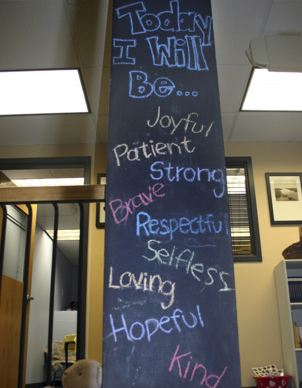 Messages on a tall chalkboard are part of the healing process at the Resiliency Center in Newtown, Conn., which offers the community mental and emotional health programs that include art, music and play therapy.