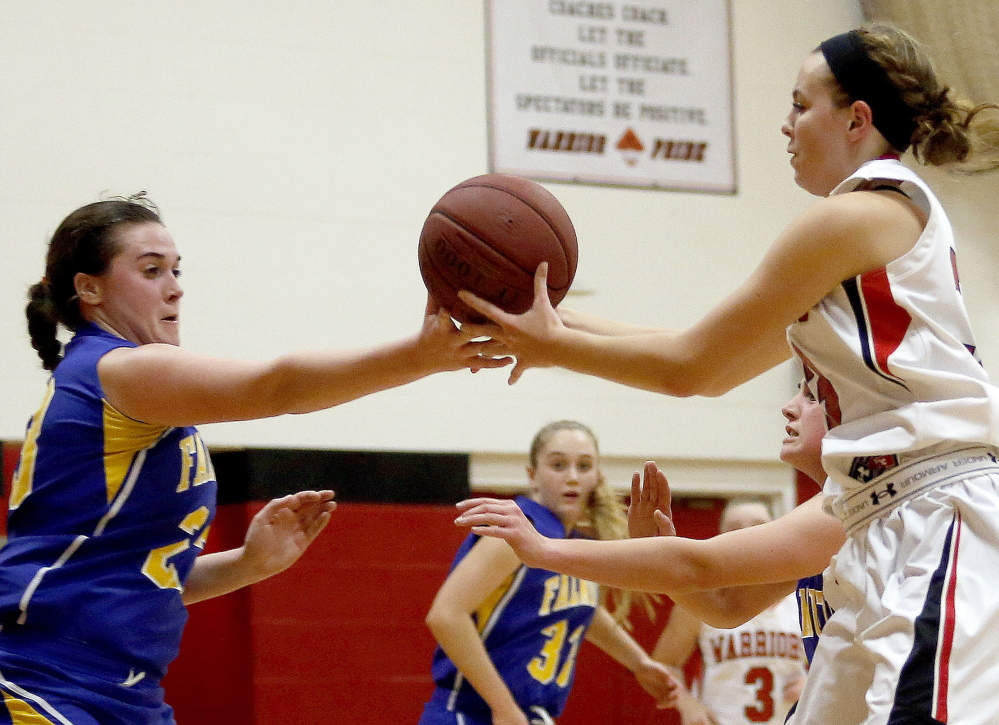 Falmouth's Jess Burton and Halee Ramsdell of Wells battle for a rebound during a Western Class B girls' basketball game Thursday night at Wells. Falmouth won 36-26.