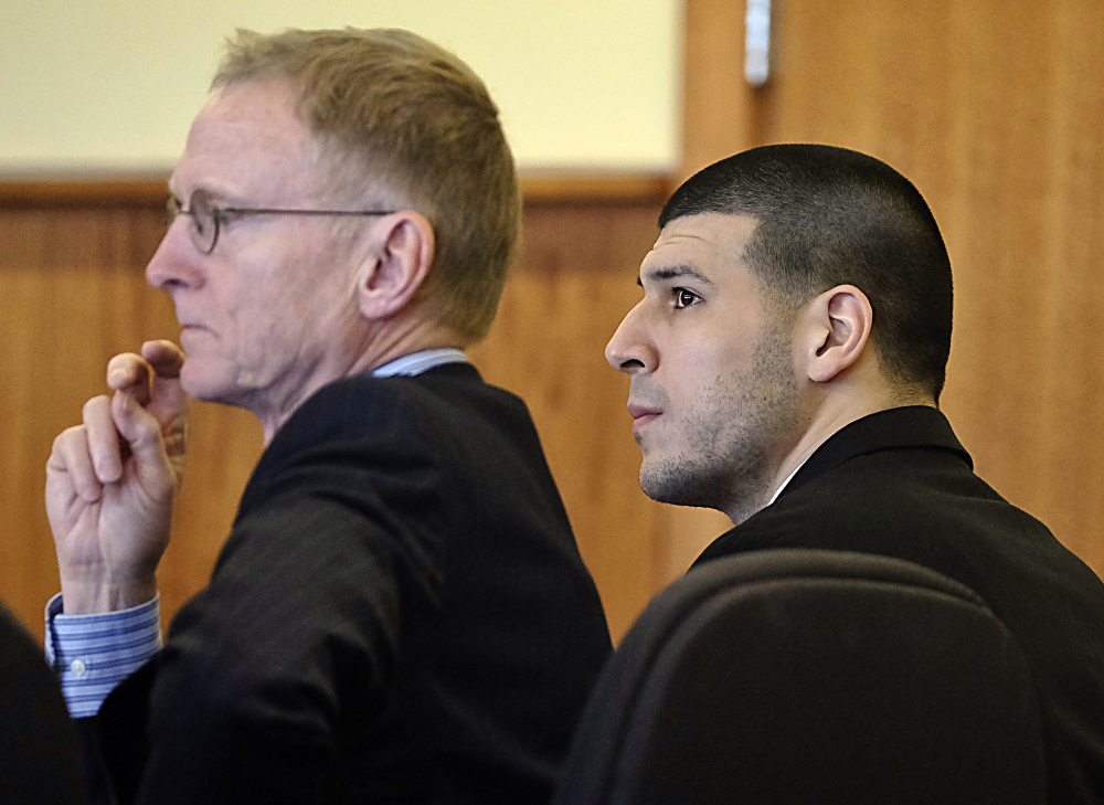 Aaron Hernandez listens with his attorney Charles Rankin, left, during a pre-trial motion hearing in Superior Court in Fall River, Mass., on Friday. Judge Susan Garsh ruled that prosecutors in the murder case against Hernandez may not tell jurors about two other killings with which the he is charged. AP Photo/The Boston Globe, Robert E. Klein