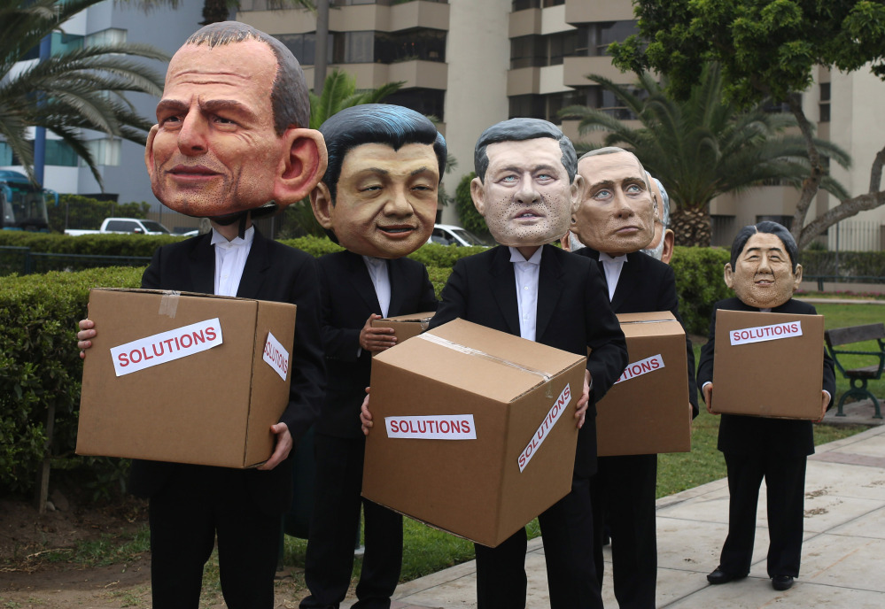 Environmental activists dress as world leaders during the Climate Change Conference COP20 in Lima Peru. Delegates from more than 190 countries are meeting in Lima to work on drafts for a global climate deal that is supposed to be adopted next year in Paris.