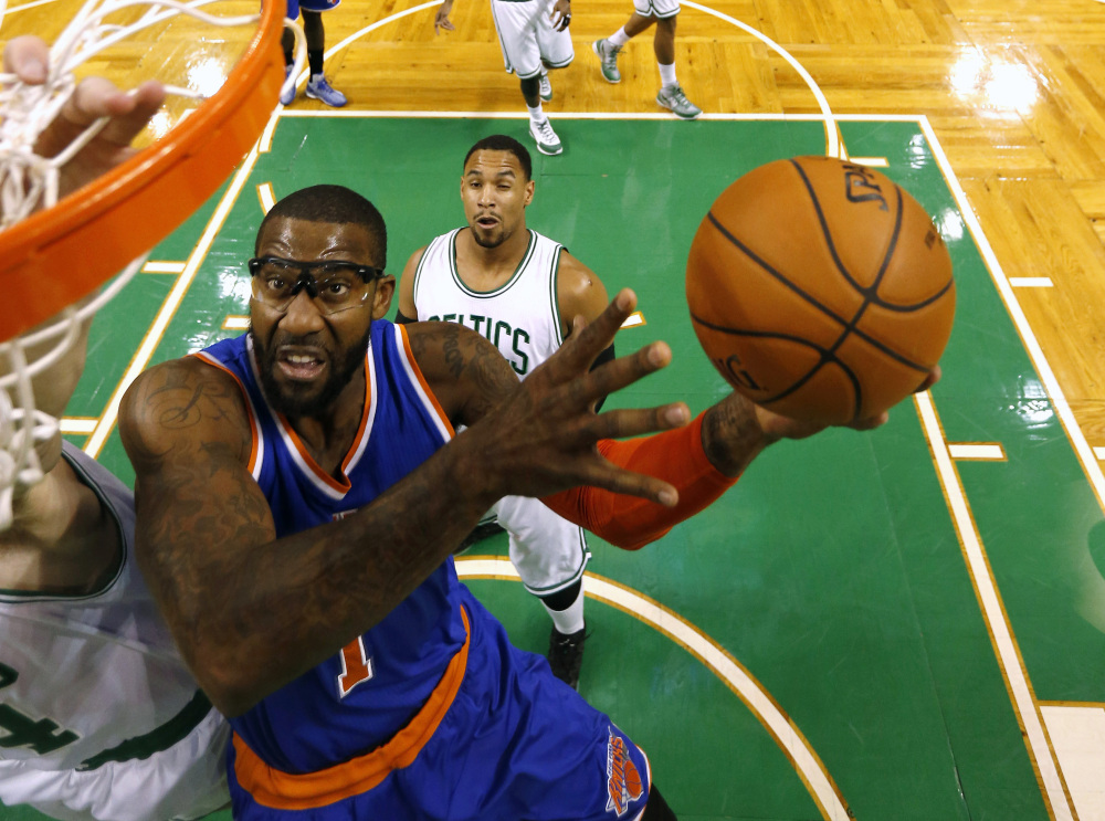 New York's Amar'e Stoudemire goes to the basket as the Celtics' Jared Sullinger defends during the second quarter of Friday night's game in Boston. The Knicks won, 101-95, to end a 10-game losing streak.