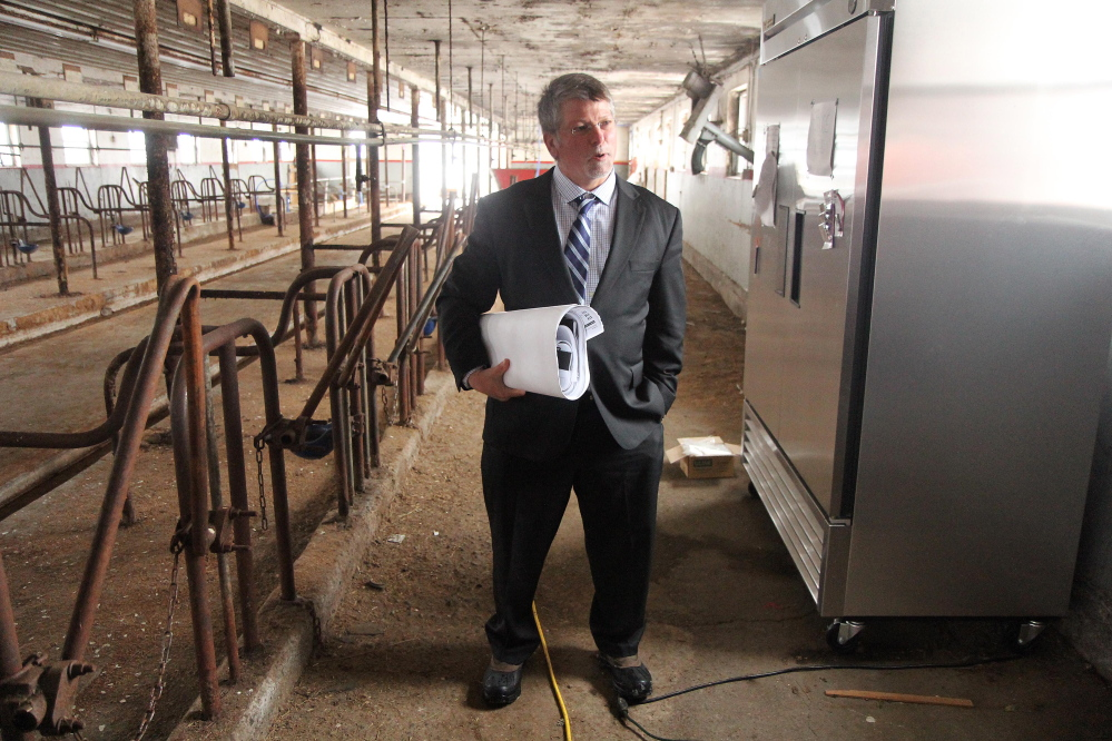 Kennebec Valley Community College President Richard Hopper stands inside an old dairy barn that will soon be converted to a field-based education center and food processing facility at the Harold Alfond Campus in Hinckley as part of the school's sustainable agriculture program.
