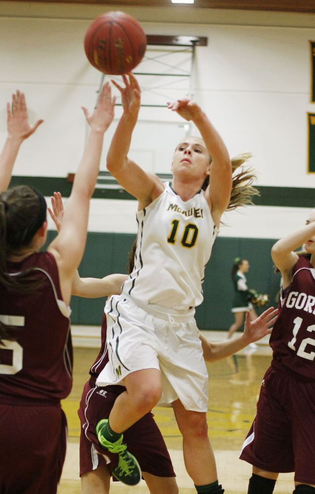 Ayla Tartre finds an opening between three Gorham defenders to launch a shot. Tartre paced a balanced attack with 14 points as McAuley bounced back from a season-opening loss to Thornton Academy, handing Gorham its first loss.