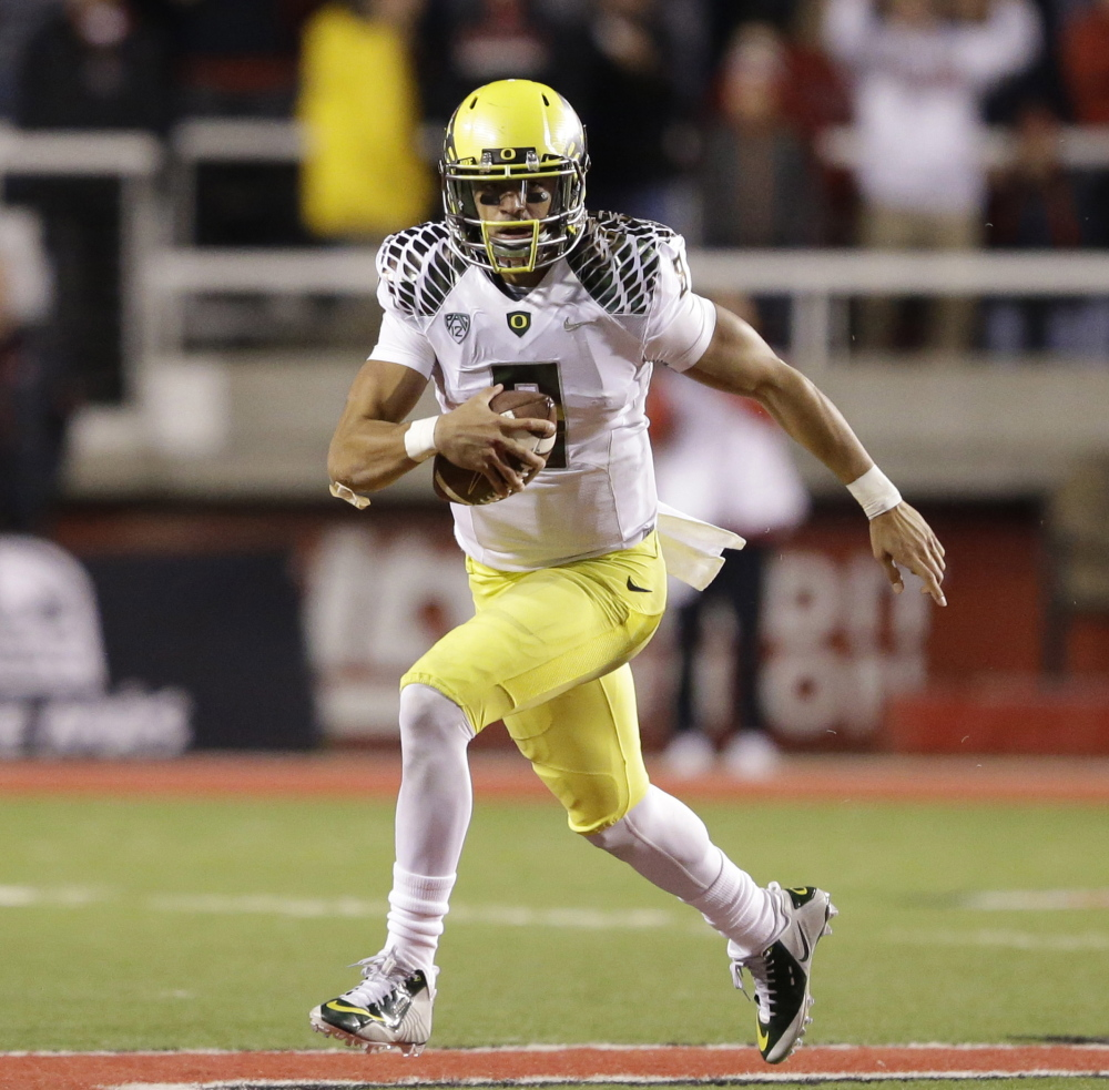 Oregon quarterback Marcus Mariota is the clear favorite to win college football's Heisman trophy, ahead of fellow finalists running back Melvin Gordon of Wisconsin and wide receiver Amari Cooper of Alabama.