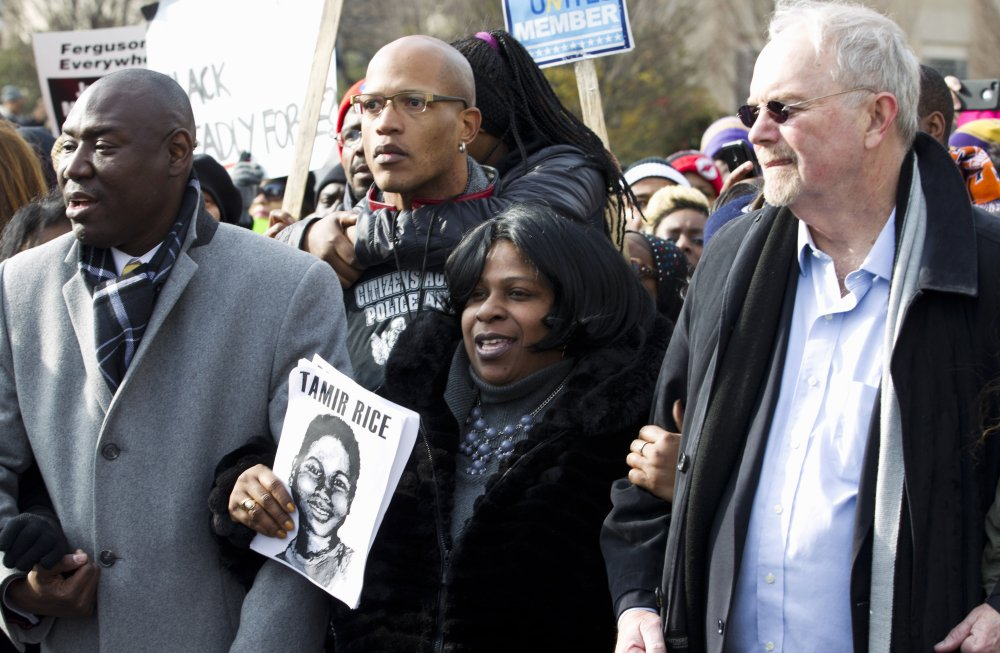 Samaria Rice center, the mother of Tamir Rice, the 12-year old boy who was fatally shot by police officer in Cleveland, and others, march in Pennsylvania Avenue toward Capitol Hill in Washington, Saturday,  during the Justice for All rally. The Associated Press