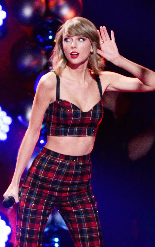 Taylor Swift celebrates her 25th birthday in style at the stroke of midnight at Madison Square Garden.