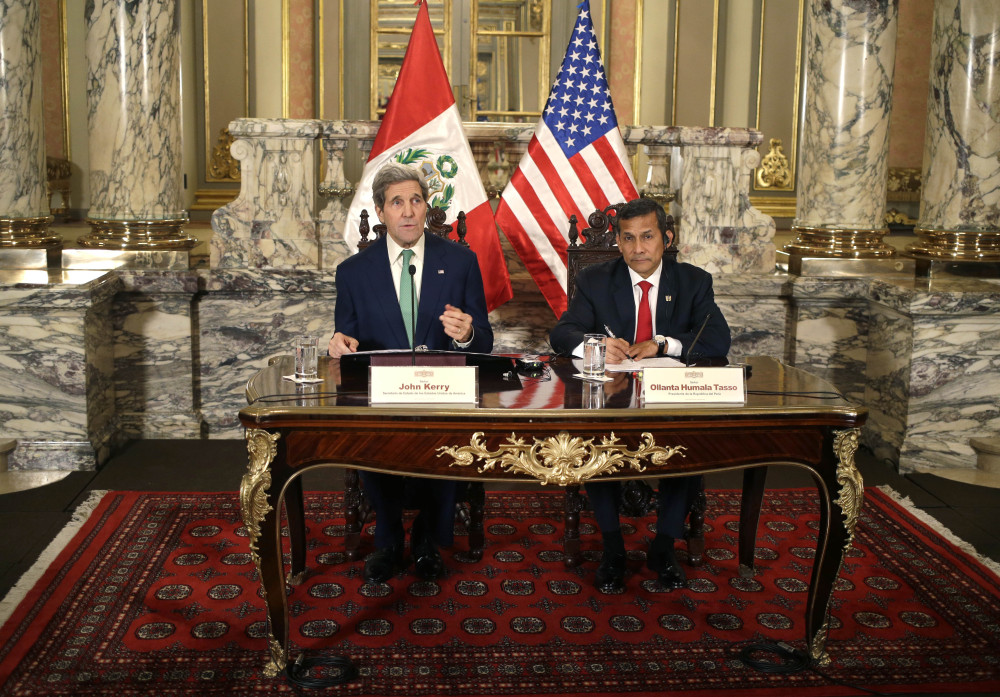 U.S. Secretary of State John Kerry, left, speaks to the press as he sits with Peru's President Ollanta Humala after a private meeting at the government palace in Lima, Peru, on Thursday. Kerry is in Lima, along with delegates from more than 190 countries, to work on drafts for a global climate deal that is supposed to be adopted next year in Paris. The Associated Press