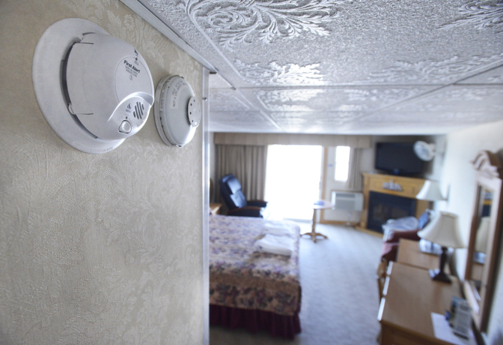 The Lafayette Oceanfront Resort on Wells Beach has combination smoke and carbon monoxide detectors, left, and heat detectors in all its rooms. CO detectors are currently required only in multifamily and rental housing as well as newer single-family homes and hotels, but a Windham legislator plans to submit a bill to mandate the devices in older buildings as well.