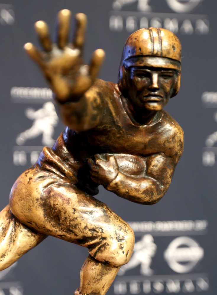 The Heisman Trophy is displayed prior to the announcement of the winner Saturday in New York. The Associated Press