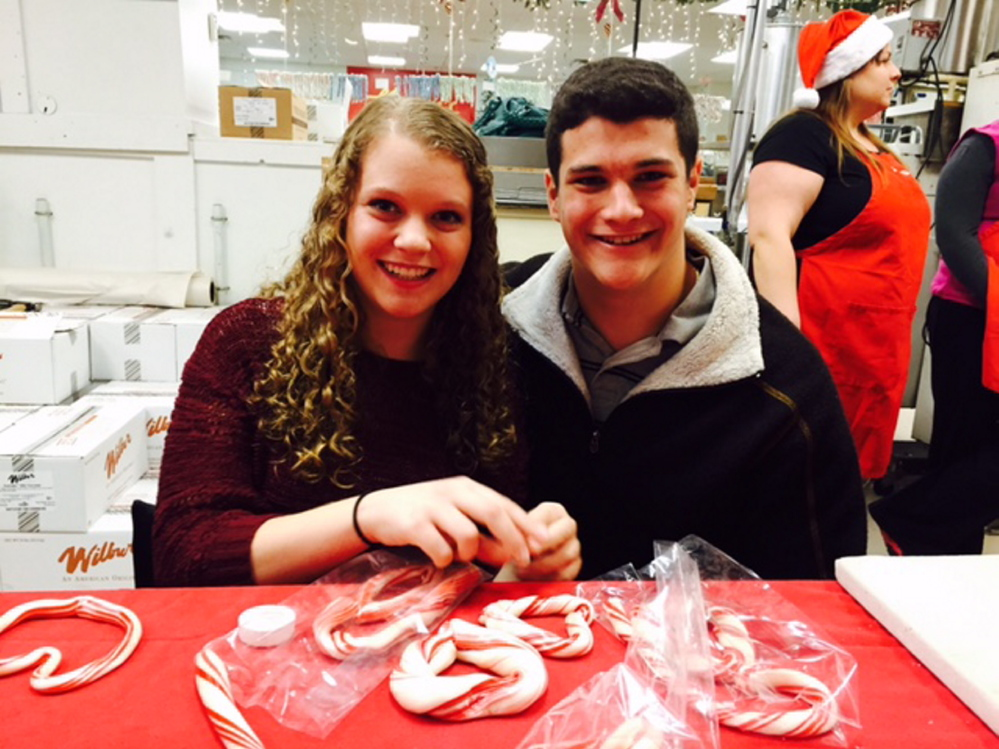 Corinne Latti (a dream recipient candidate for the Dream Factory of Maine) and her brother Mike Latti make candy canes during a fundraiser event hosted by Haven's Candies of Westbrook. The event raised more than $15,785 to sponsor three Maine chronically ill Maine children and fulfill their dream wish in 2015. Photo courtesy Jennifer McBrierty.