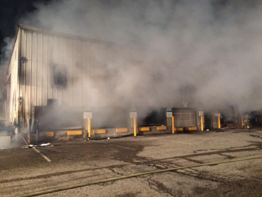 Smoke billows from the Wells transfer station that was heavily damaged by fire early Sunday. Photo courtesy of the Wells Police Department