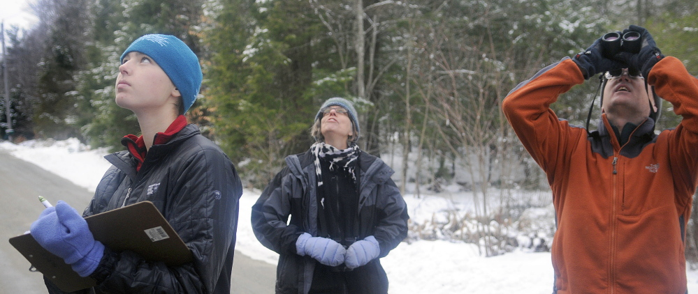 Anna Hodgkins, left, Tina Wood and Hodgkins' father, Glenn, record birds in Farmingdale while participating in the annual Christmas Bird Count on Sunday.