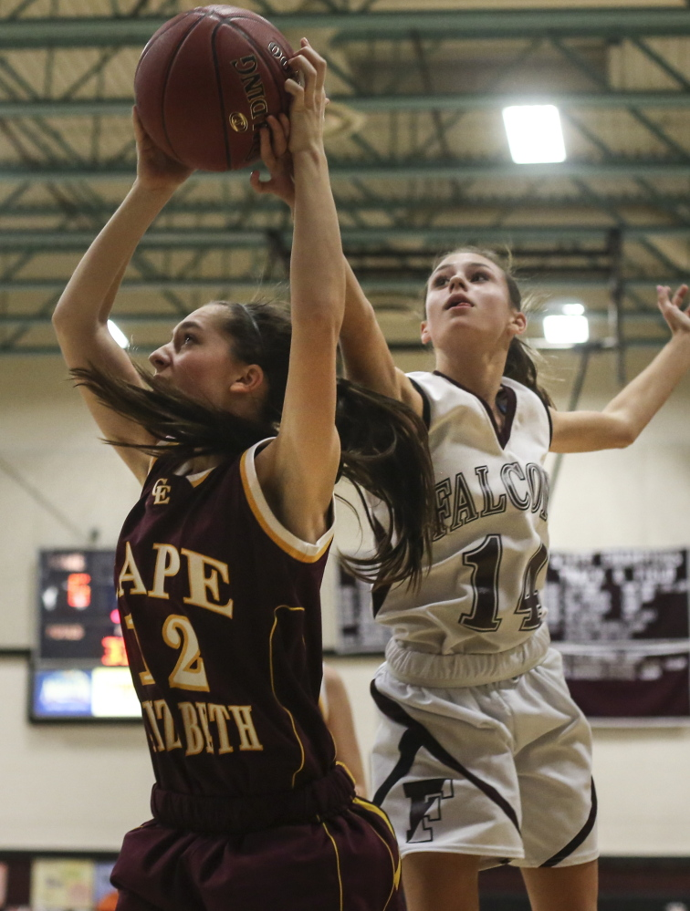 Cape Elizabeth guard Mo Lavallee grabs a rebound as Freeport guard Taylor Rinaldi fights for the ball during the Capers' 62-47 win Monday at Freeport High School.