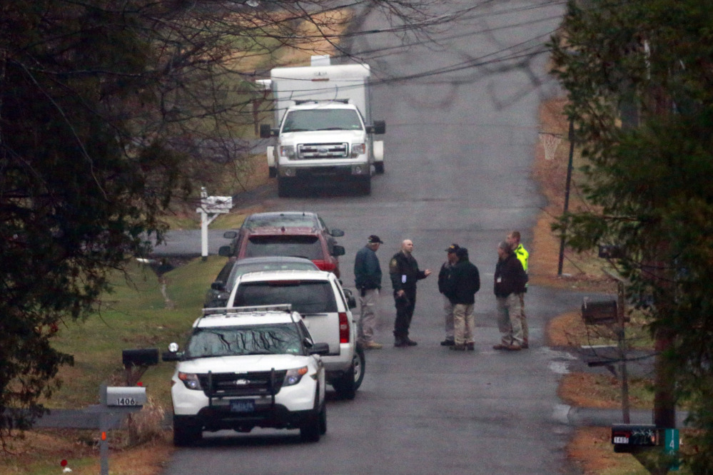 Investigators gather in a wooded area of Pennsburg, Pa., near where the body of Bradley William Stone was discovered Tuesday. The Iraq War veteran who was suspected of killing his ex-wife and five of her relatives was found dead in the woods near his home after a day-and-a-half manhunt.