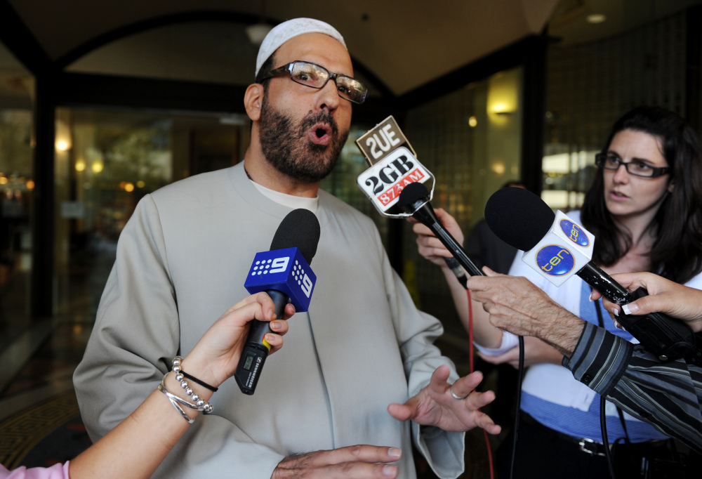 In this April 18, 2011 file photo, Man Haron Monis speaks to the media as he leaves the Downing Centre in Sydney after a pre-trial hearing where he is accused of sending offending letters to the families of soldiers killed in Afghanistan.