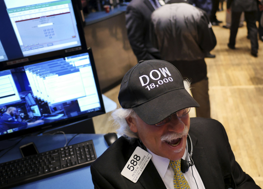"""Peter Tuchman wears a """"DOW 18,000"""" hat on the floor of the New York Stock Exchange on Tuesday, when U.S. stocks pushed farther into record territory."""