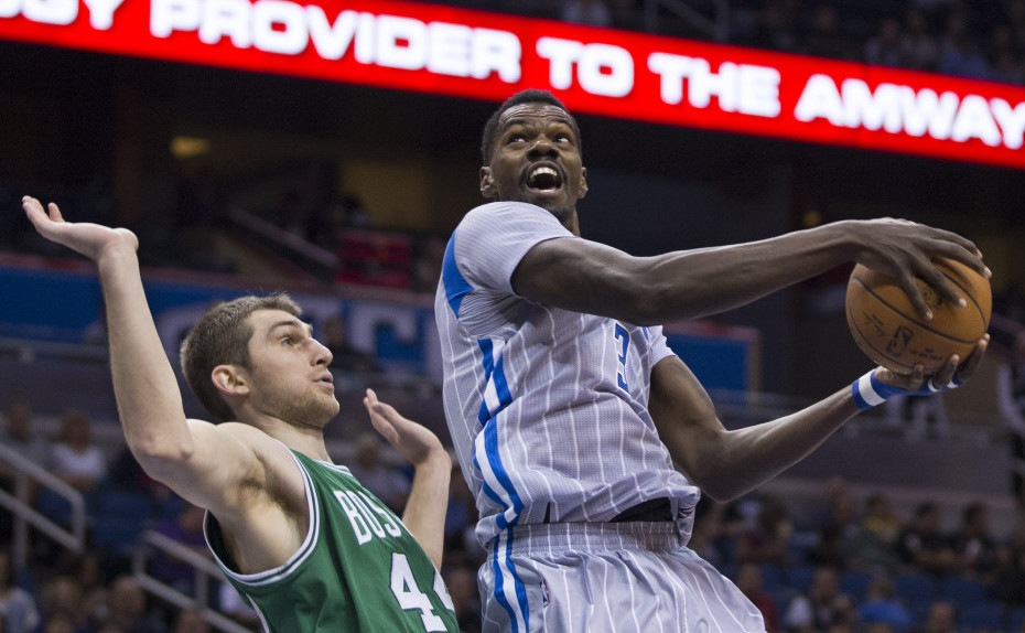 Orlando's Dewayne Dedmon looks to shoot past Boston's Tyler Zeller during the first half of Tuesday night's game in Orlando, Fla. Zeller led the Celtics with 22 points and 10 rebounds.