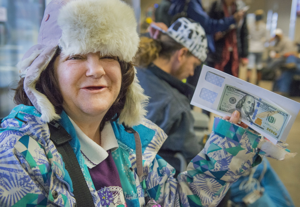 Heather Clark says she had never seen a $100 bill until Wednesday, when Secret Santa handed her an envelope at the Portland bus terminal.