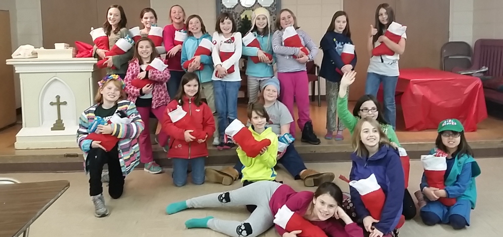 Members of Portland's Girl Scout Troop 1714 filled stockings for residents of the Preble Street Teen Shelter.