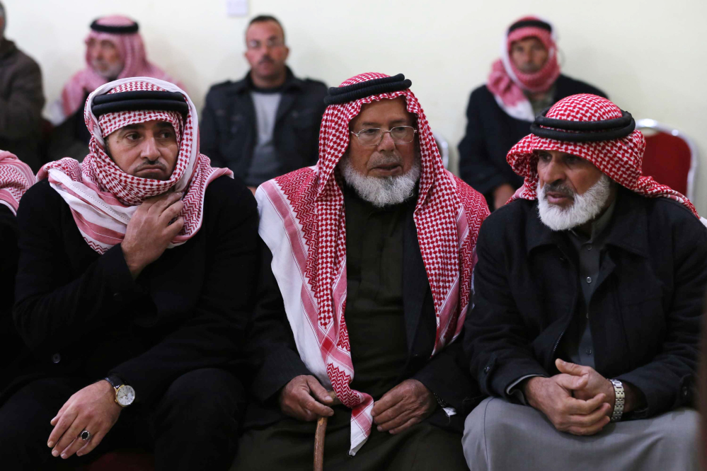 Friends and relatives of Mu'ath Safi al-Kaseasbeh, a Jordanian pilot captured by the Islamic State group, gather in the town of Aey near Al Karak in southern Jordan, on Wednesday.