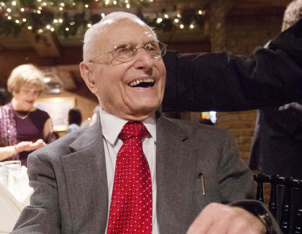 Charlie Ponti laughs during a holiday party in New York. The 101-year-old is finally ready to retire Dec. 31.