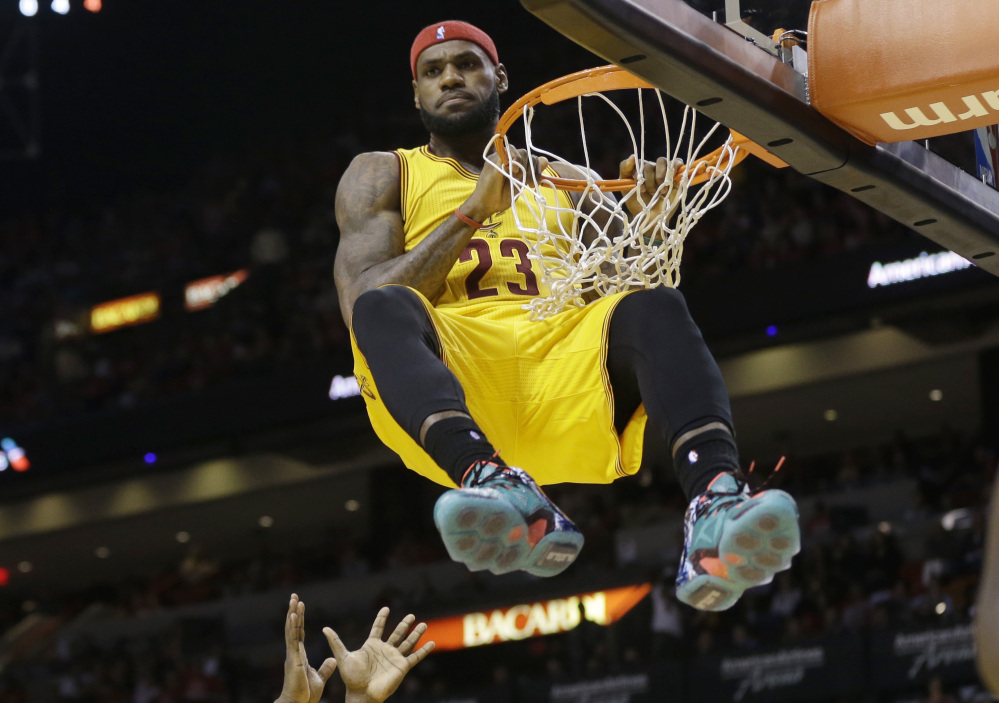 LeBron James hung around Miami for four seasons. Thursday, he was simply hanging on the rim after a dunk. And yes, it was a technical. James, now back with Cleveland, scored 30 points in a loss in his return to Miami.