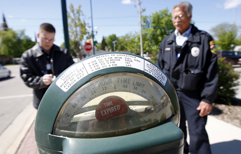 Parking meters like this one in Sycamore, Ill., still accept pennies as the city of 18,000 residents west of Chicago encourages downtown traffic with its cheap prices.