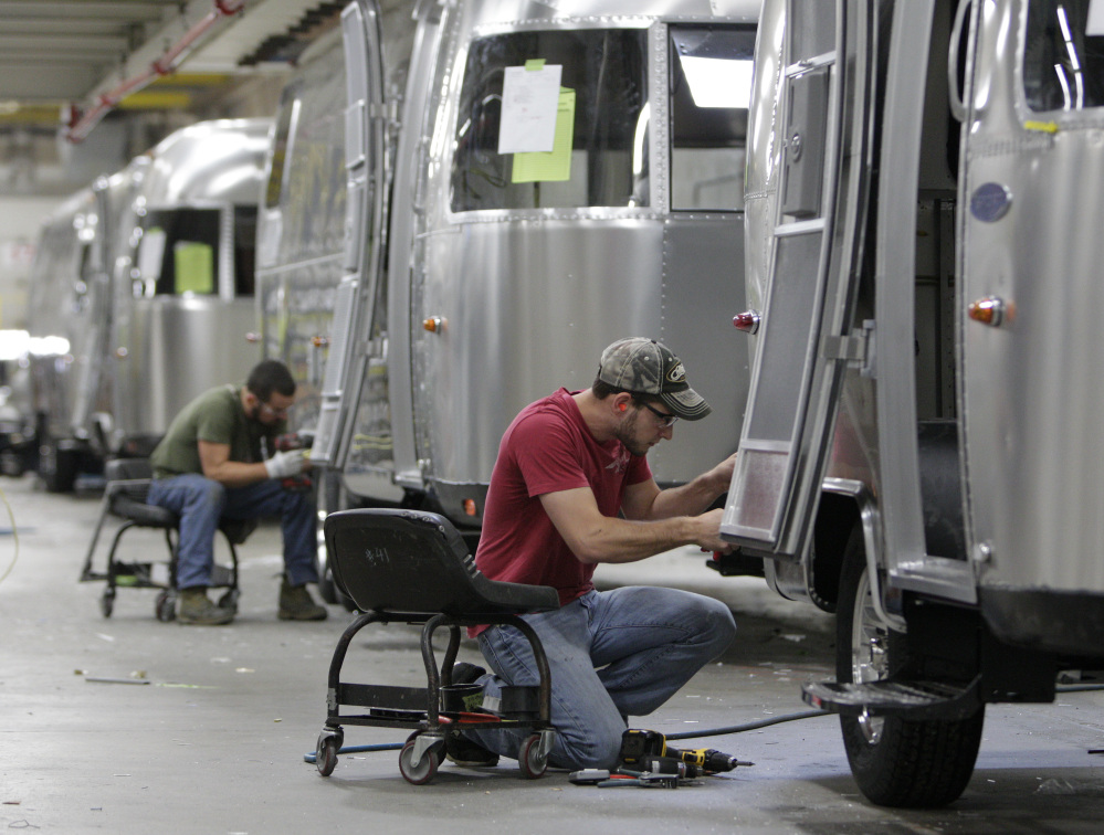 Jordan Peterson of Bellefontaine, Ohio, works on an Airstream travel-trailer at the company's factory in Jackson Center, Ohio, in October. Airstream builds 50 of the retro-looking campers every week at its plant, but is undertaking an expansion to meet the rising demand from devotees who don't want to wait until retirement to hit the road.