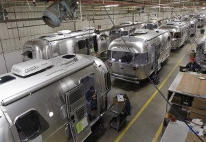 """Airstream campers line the factory floor in Jackson Center, Ohio. The iconic travel-trailers have appeared in many movies, including """"Raising Arizona"""" and """"Independence Day."""""""