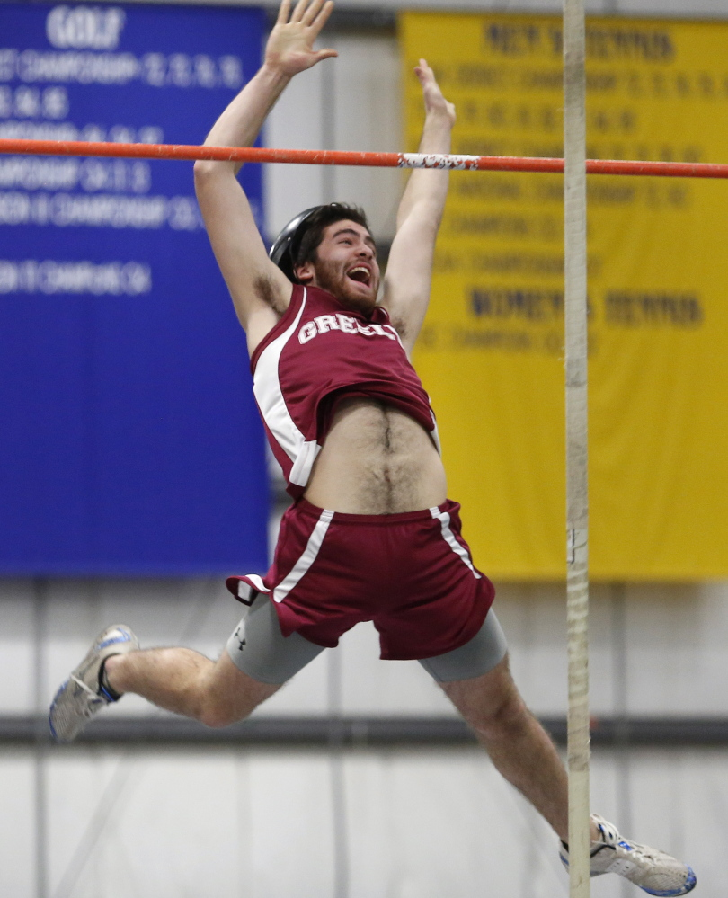 Ben Ray of Greely clears the bar with a smile while competing in the pole vault. Ray finished fourth in the event with a vault of 11 feet, 6 inches.