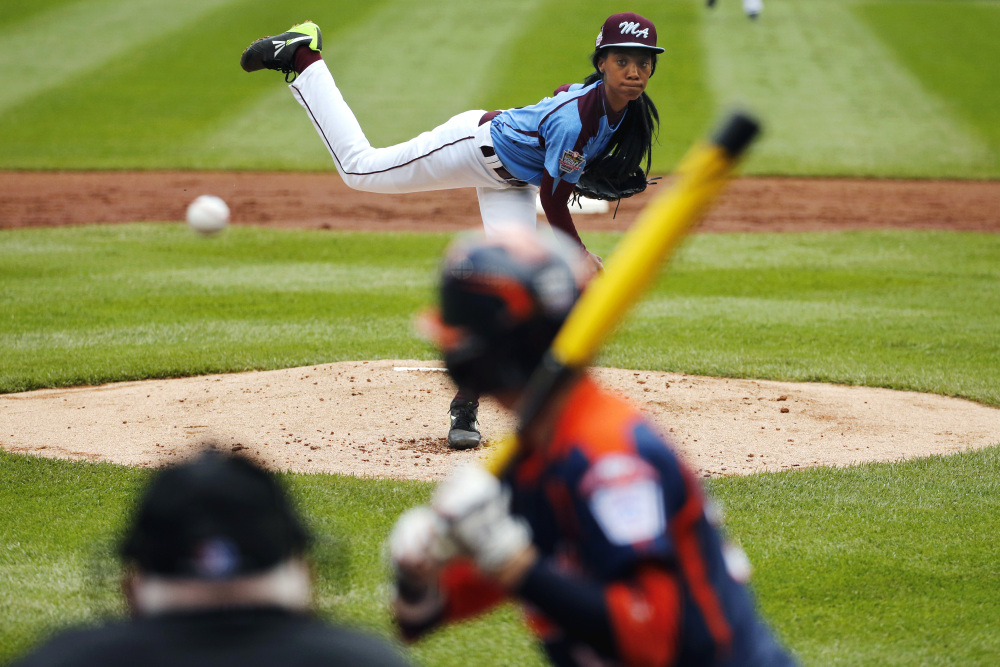 In this Aug. 15, 2014, file photo, Philadelphia's Mo'ne Davis delivers in the first inning against Nashville's Robert Hassell III during a baseball game in U.S. pool play at the Little League World Series tournament in South Williamsport, Pa.