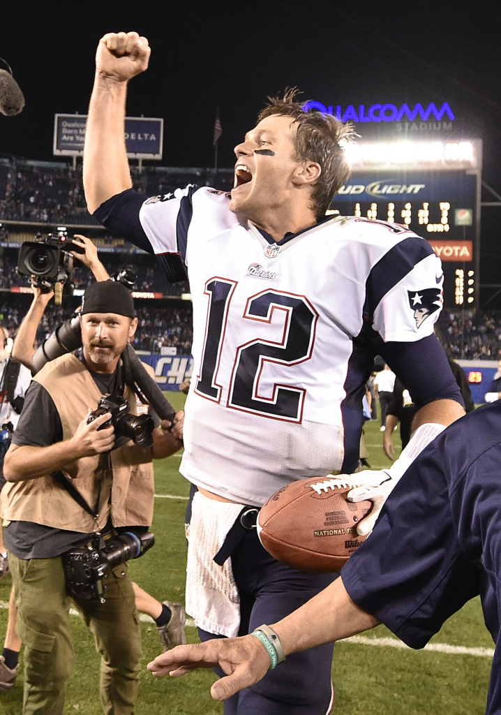 New England Patriots quarterback Tom Brady celebrates after the Patriots beat the San Diego Chargers 23-14, Sunday in San Diego.  The Associated Press