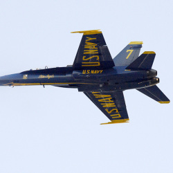 A Blue Angels F/A Hornet, flown by Capt. Jeff Kuss and Capt. Corrie Mays, does a publicity flyover at Brunswick Executive Airport. After landing, it slid off the runway.