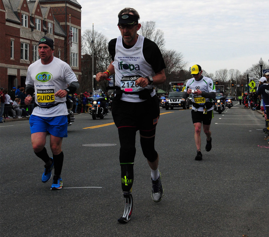 Richard Blalock reaches the finish line of the 2013 Boston Marathon.