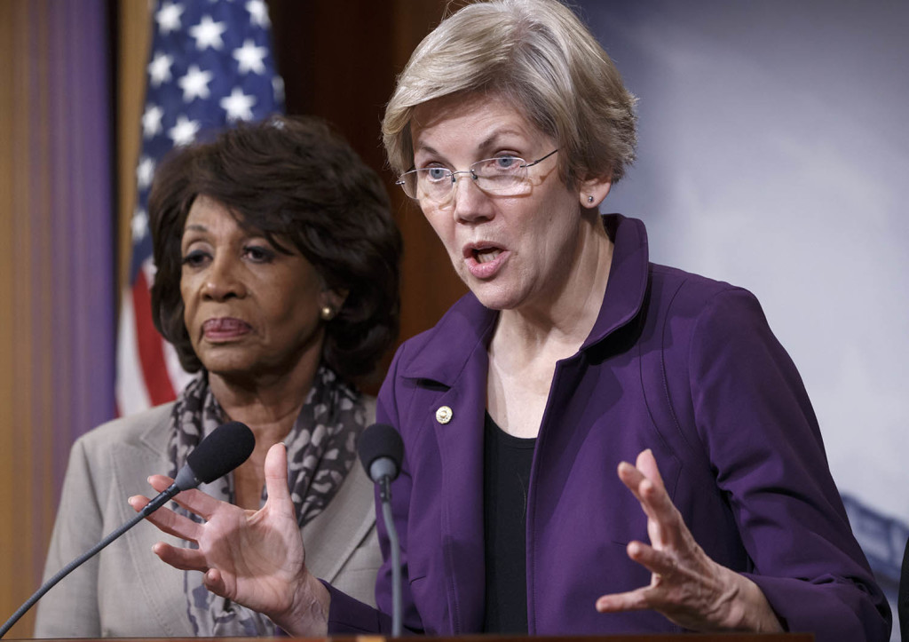 Sen. Elizabeth Warren, D-Mass., a member of the Senate Banking Committee, and Rep. Maxine Waters, D-Calif., left, ranking member of the House Financial Services Committee, express their outrage to reporters Wednesday that a huge, $1.1 trillion spending bill passed by the Republican-controlled House contains changes to the 2010 Dodd-Frank law that regulates complex financial instruments. Democratic support for the omnibus bill faded as liberal lawmakers erupted over the financial regulation provision and another that allows more money to flood into political parties.