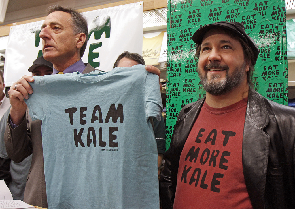 Vermont Gov. Peter Shumlin holds a Team Kale T-shirt during a news conference with Bo Muller-Moore in 2011.