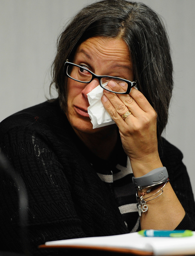Kathleen Flaherty, a member of the Sandy Hook Advisory Commission, wipes her eye during a presentation last month by two families who lost children in the Sandy Hook Elementary School shooting in Newtown, Conn. The parents made presentations on ways to better address mental health, school safety and gun violence prevention.